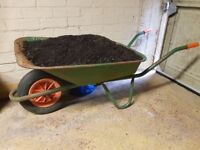 Strong metal wheelbarrow plus about 3 bags of used-once peat