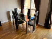 Dining table and chairs set with extendable ends