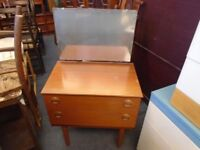 tiny vintage dressing table with 2 drawers and a mirror.