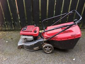 Petrol lawn mower in working condition wheel missing best for parts