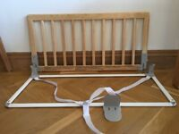 Baby Dan bed guard in natural wood