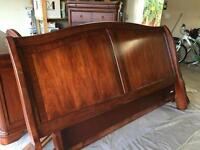 Solid wood king size head board and foot board.