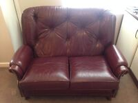 Vintage looking two seater sofa with stool and throw
