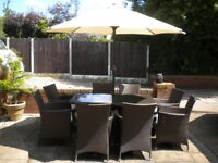 EX DISPLAY RATTAN GARDEN TABLE AND 8 CHAIRS WITH PARASOL
