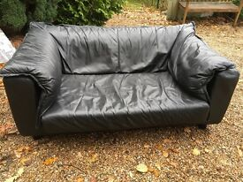 Loose soft leather two seater black leather sofa