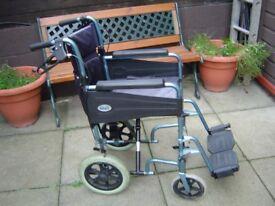 Fold away wheel chair.