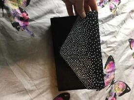 Black sparkly clutch bag