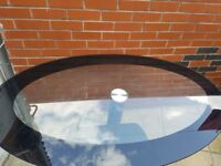 Glass dining table black oval