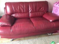 Red leather 3 & 2 seater sofa with foot stool for sale. £200 Ono. Pick up only.