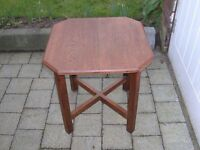 A small octagonal wooden table.