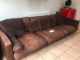 Brown Leather Sofa - Ideal for families with young children