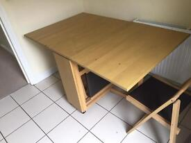 Folding dining table and chairs.