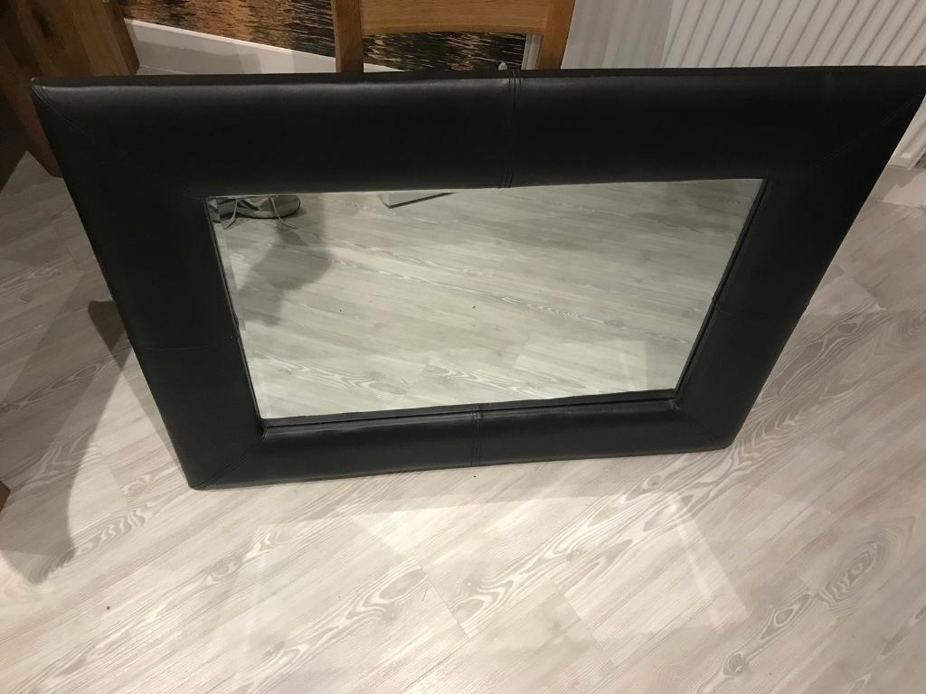 Black leather framed mirror