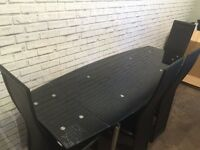 Harvey's glass table and chairs Need gone ASAP!!!!