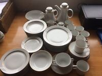 58 piece White porcelain with a fine gold band dinner service. Simple and Stylish