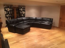 Black leather reclining corner sofa and 2 seater sofa and storage footstool