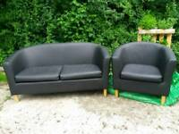 Black vinyl sofa. Two seater and single seater £45 or ono.