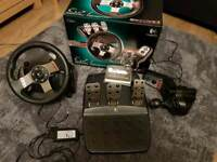 Logitech G27 Leather Racing Wheel with pedals and gearbox.