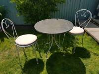 Granite garden table & heart shaped cast iron chairs