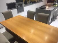 Oak vaneer table and 6 upholstered chairs
