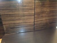 5 used high gloss wood veneer units could be used in a kicthen 1 door slighty damaged