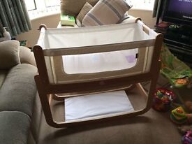 This is a SnuzPod2, 3 in 1 Bedside Crib it is in as new condition complete with mattress.