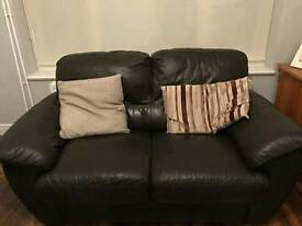 2x brown leathers sofas