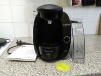 Tassimo coffee maker and pod holder