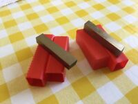 Two pieces of 1/2 inch square steel lathe tool bits