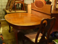 Solid wood oval dining table and four chairs