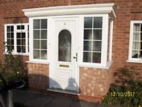 Used white UPVC porch with double glazed windows and door