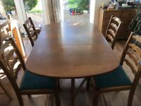 Solid oak drop-leaf table, 4 chairs and sideboard. Bought from Maskreys in 1950s.