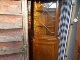 A lovely glazed lightwood corner cabinet