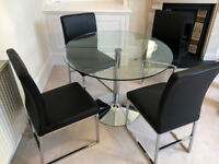 Round Glass Dining Table & 4 Black Faux Leather Dining Chairs in good condition