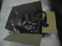 A box of brand new computer or audio headphones...