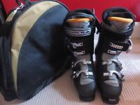 Mens ski boots size 8.5. worn 4 times some scuffing but good condition, with bag.