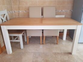 Solid wood extending dining table with chairs