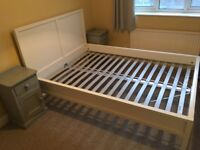 White wood double bed frame with pair of grey painted side tables