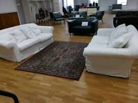 Beautiful white fabric sofa with scatterback cushions and button design 3 and 2 seater