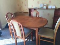 Dining room table and 6 matching chairs