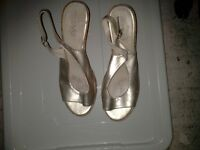 Ladies Gold open toe wedged heel shoe, buckle fastening size 6