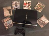PlayStation 3 with 6 games PS3