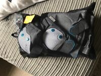 Elbow pads, knee pads, wrist protectors. Brand new in bag still.