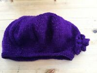Brand new handmade knitted purple glitter Beret with flower. One size/ Very pretty. £3. Torquay or c