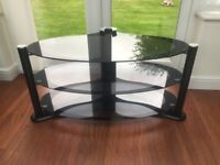 Quality tv stand in smoked glass finish other parts in black ,will take up to 50 inch led tv