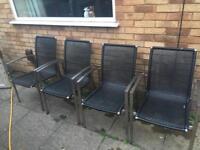 Four black garden chairs