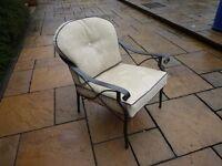 single black galvanized steel easy chair - good condition