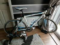 Carrera virtuoso road bike with home trainer and size 9 shoes
