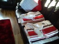2 pair of cream and red curtains