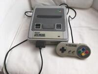 SNES console + gamepad